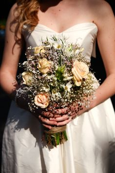 Fox and Rabbit Flowers. Champagne Roses with white baby's breath...