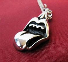 The smaller of 2 316L Stainless Steel Lips & Tongue Pendant