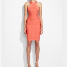 HERVE LEGER CRISS CROSS KEY HOLE FRONT OPEN BACK Stunning coral color. Perfect for a spring/summer occasion. Criss cross keyhole top with an open back. Bandage dress that will make you standout in the crowd. Herve Leger Dresses Midi