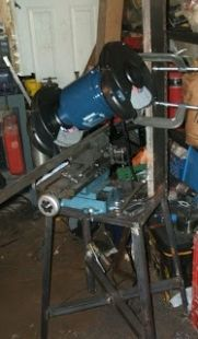 Surface Grinder - Homemade surface grinder constructed from a bench grinder, cross slide, angle iron, steel plate, and bar stock.