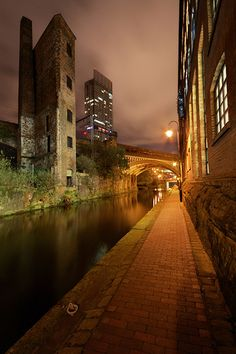 "Manchester photographed at night from the banks of the canal which runs throught the city centre below street level. This photo was exhibited at the cities ""Cube"" gallery as one of the winners of the 2009 ""Capture Manchester"" competition. Visit Manchester, Manchester England, Manchester Travel, City Photography, Landscape Photography, Bolivia, Level Design, Salford, Night City"