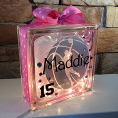 GemLights are custom made to order. GemLights are 8x8x3 glass block filled with sparkle mesh and lights and customized on the front with professional
