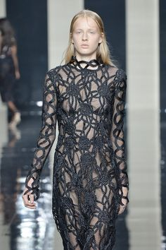An undulation of rope appliqué snakes its way around this model at@ChristopherKane. #LFW #SS15