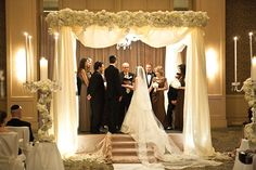 Love the way the draping softens the Chuppah