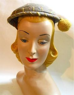 1930s confetti flecked felted wool cap with yellow top stitching and pom pom on stem off to side. Wire clips inside to hold to head. No flaws, size 22.