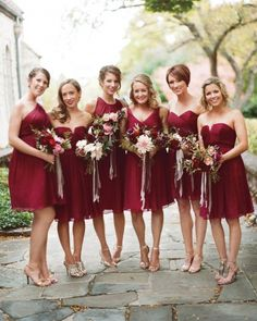 The bridesmaids chose chiffon J.Crew dresses in different cuts but the same ruby shade.