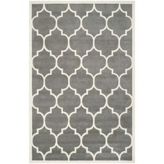 With a modern depiction of a Moroccan classic design, this dark-gray wool rug with ivory accents features a dense 0.5-inch pile, giving it a luxuriously rich feel. Subtle and stylish, this rug will compliment your modern decor and furnishings.