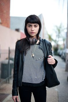 Vanessa Moreira. Full fringe, tapered but still blunt and graphic. Oval to round face shape.