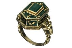 enamel, gold, and emerald poison ring from the Victorian Era featuring ram's heads, an occult symbol
