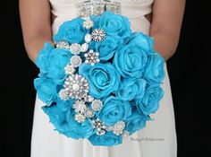 Malibu blue wedding flowers with Jewels.  Complete wedding flower package with Bride, Maid of Honor, Throw Bouquet, Groom and Bestman for only $300