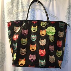 Cat Face Holiday Tote from Sally's Beauty This adorable tote is a limited Holiday edition with funny and colorful cat faces all over.  Has a satin/nylon finish, zipper close an faux patent leather straps. So cute and fun! Good size too, so can be used for shopping, as a big purse, for the beach... You name it! Smoke Free Home Bags Totes