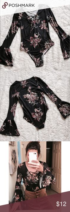 Floral Long-sleeve Bodysuit Long sleeve floral bodysuit top from Target. Black with floral design. Cotton material. Only worn once! There is one spot that seems picked from stretching the top. You don't notice the spot while wearing the top. Tops Tees - Long Sleeve