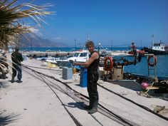 Fishermen fixing their nets in the beautiful resort of Kardamena in Kos. For more information check out www.kosexplorer.com