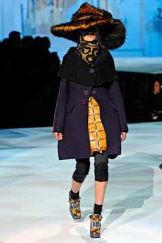 FW12 - Daria: Double-Faced Shetland Stole;   Double-Faced Shetland Coat; Patchwork Kangaroo Skirt; Satin Pant; Embroidered Silk Scarf; Lurex Argyle Sock; Embroidered Shoe; Beaver Hat
