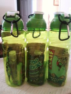 Goody bottles for a rock climbing themed birthday party. Water bottle filled with Cliff Bars, Pop Rocks, gum, hand sanitizer, a hair tie and a carabiner.