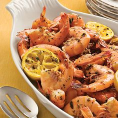 Beach Shrimp    This easy baked shrimp dish will transport your taste buds to the beach no matter where you eat it. Your whole family will love the fresh flavor. Simply mix shrimp with bottled Italian dressing and garlic cloves; top with lemon halves, parsley, and butter; and bake.  SO SIMPLE AND GOOD