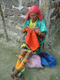 "Picture of Kuna woman by N3074Echo. Women in Kuna Yala wrap colorful beads around their legs. The beaded adornments, known as ""winis"", are long strings of beads that create intricate and beautiful patterns."