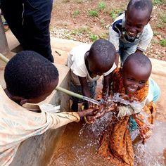 Kids enjoying clean water in Kanombe Sector, Rwanda.