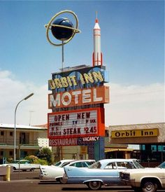 1950s, Orbit Inn Motel - Check out the fantastic space era / atomic design sign and those spaceship wing cars! -- (mid century modern, vintage photo)