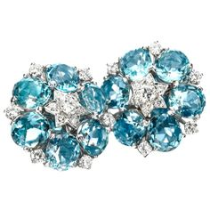 Van Cleef & Arpels, A Pair of Aquamarine and Diamond Ear Clips, each designed as a cluster of circular-cut aquamarines, accented by circular-cut diamonds, mounted in platinum, signed Van Cleef & Arpels, numbered NY12592, circa 1947.  Photo c/o FD Gallery
