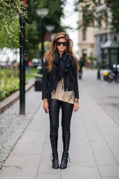 It is mostly black but the yellowish color adds a pop to this outfit. Not only is she wearing a jacket but a scarf as well. Instead of having wide legged pants they are skinny which is more suitable for this outfit. I am superbly glad they used ankle boots instead of sneakers or taller boots.