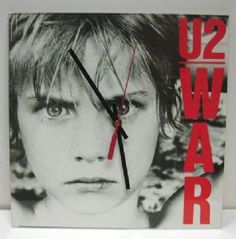 """Relive the 80's with U2's classic album War. Measures 10 1/2"""" x 10 1/2"""", quartz movement and requires 1 AA battery.  Our Price: $32.95  Availability: In Stock"""