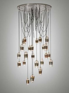 Silver Stripe Chandelier - Alison Berger: Each of the hand blown crystals has a mirrored surface created by oxidizing colored glass which glows red when lit