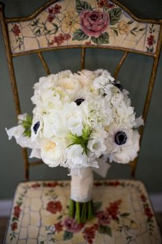 Gorgeous white bouquet with pops of black anemones. Rebecca Calagna Events.