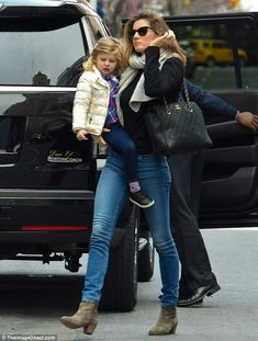 Hot mama! The Brazilian beauty showed off her svelte physique in denim skinny jeans and fitted blazer