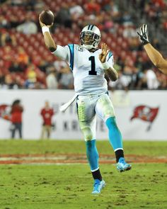 Quarterback Cam Newton #1 of the Carolina Panthers releases a pass against the Tampa Bay Buccaneers at Raymond James Stadium on October 24, 2013 in Tampa, Florida.