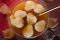 A punch recipe with a balanced flavor of brandy, pear juice, pear cider, and cinnamon schnapps; serve it at a Halloween, Thanksgiving, or Christmas party.