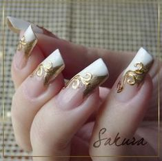 White and gold French tips with gold swirl