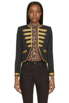 Classic Military Jacket by Saint Laurent. Long sleeve jacket in black. Tonal slub effect throughout. Metallic gold ribbed trim throughout. Crewneck collar. Open front with brass tone accent buttons. Welt pockets at front. Fully lined. Tonal stitching. http://www.zocko.com/z/JJSCO