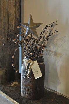 Mason jar painted brown.. rustic vase
