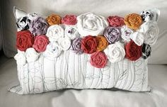 Love this pillow. http://youcouldmakethat.blogspot.com/2012/02/fabric-roses-spring-and-giveaway.html