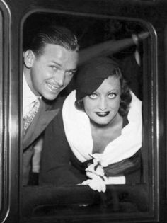 US-american actress Joan Crawford and her husband Douglas Fairbanks jr. at their depature from London/Viktoria Station. Die US-amerikanische Schauspielerin Joan Crawford. Get premium, high resolution news photos at Getty Images Old Hollywood Glamour, Hollywood Actor, Golden Age Of Hollywood, Vintage Hollywood, Hollywood Stars, Classic Hollywood, Hollywood Couples, Classic Movie Stars, Classic Movies