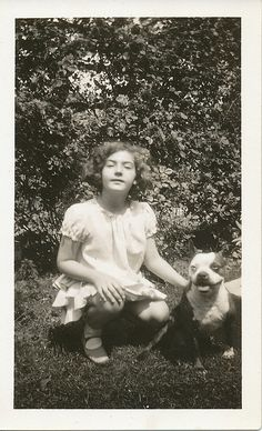 Girl with a pit bull friend