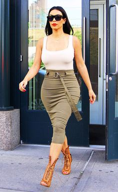 Kim Kardashian shows off her killer curves on the streets of NYC.
