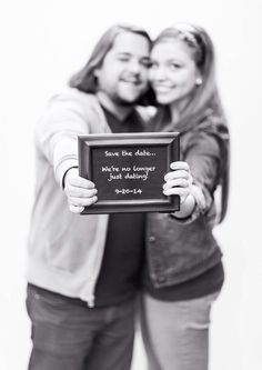 Our hair accidentally created a heart shadow behind the sign!   #engagementphotos