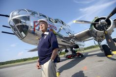 Doolittle Raider Lt. Col. Dick Cole, stands in front of a B-25 at the Destin Airport in Destin, Fla. on Tuesday April 16, 2013 before a flight as part of the Doolittle Raider 71st Anniversary Reunion. Cole was Lt. Col. Jimmy Doolittle's co-pilot during the raid. The Doolittle Tokyo Raid was a notable attack on the Japanese during World War II using B-25's. The B-25 pilots trained to take off from an aircraft carrier, which the plane was not designed to do. (AP Photo/Northwest Florida Daily…