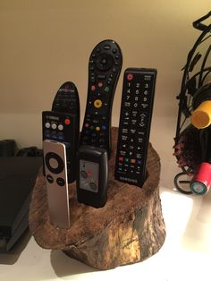 Remote control holder out of old log