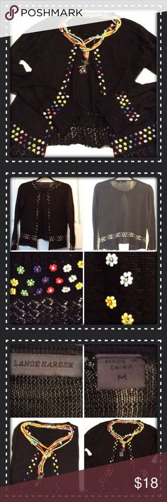 Black cardigan Black 100% silk cardigan with a delicate top bottom; meant to be worn open with delicate beading and weave on bottom & sleeves; the beading runs down the front; no rips or stains; excellent condition; great to wear over dresses or tops; fits 6/8 Lance Karesh Sweaters Cardigans