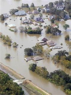Houses are partially submerged in flood waters after a Hurricane Isaac levee breach in Braithwaite, Louisiana August 31, 2012. REUTERS/Sean Gardner
