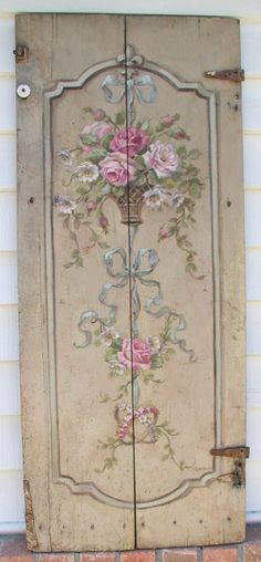 Old door embellished with hand painted roses...so shabby!