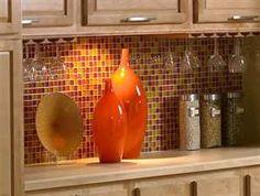 Orange kitchen love the backsplash. Would look great with my orange stove
