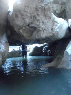 Wading through murkey waters and under precarious boulders in Saklikent gorge, Turkey