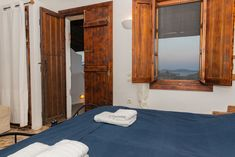 Kyma is one of the rooms of Kalderimi. Kalderimi is situated on Patmos island at an exceptional location. It is built only a few meters from the port, on a cobblestone street which leading up to Chora of Patmos.