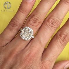 Everything about this breathtaking, one-of-a kind cushion cut diamond engagement ring is spectacular.