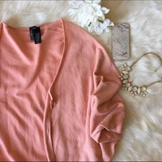 ❗️LAST CHANCE ❗️Bisou Bisou Sweater So stunning and in mint condition. Pink with light flecks of gold glitter. Never worn. Would fit a large or extra large comfortably, NO TRADES PLEASE Bisou Bisou Sweaters Shrugs & Ponchos