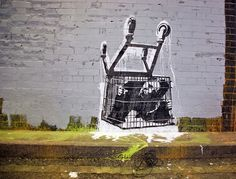 Banksy - Kid in Shopping Trolley